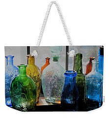Weekender Tote Bag featuring the photograph Old Bottles by John Scates