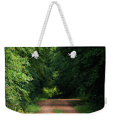 Weekender Tote Bag featuring the photograph Old Dirt Road by Shelby Young