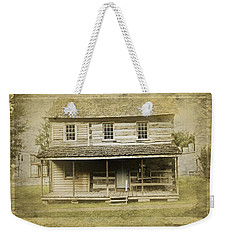Weekender Tote Bag featuring the photograph Old Log Cabin by Joan Reese