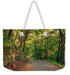 Weekender Tote Bag featuring the photograph Old Plank Road by Cricket Hackmann