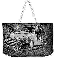 Weekender Tote Bag featuring the photograph Old Rusty Chevy In Black And White by Paul Ward