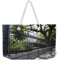 Weekender Tote Bag featuring the photograph Old Tree And Ornate Fence by Todd Blanchard