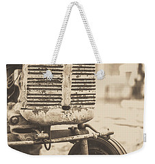 Weekender Tote Bag featuring the photograph Old Vintage Tractor Brown Toned by Edward Fielding