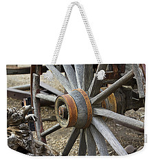 Weekender Tote Bag featuring the photograph Old Waagon Wheel by Phyllis Denton