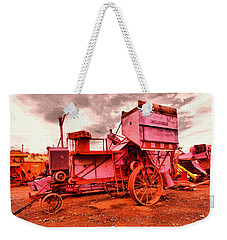 Weekender Tote Bag featuring the photograph Old Wheat Harvestor by Jeff Swan