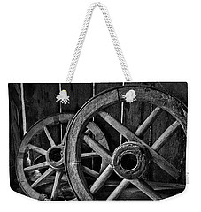 Weekender Tote Bag featuring the photograph Old Wooden Wheels by Stuart Litoff