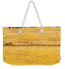 Weekender Tote Bag featuring the photograph Old Yellow Paint On Wood by John Williams