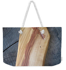 Weekender Tote Bag featuring the photograph Olive Wood Cross by Marie Neder