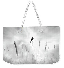 Weekender Tote Bag featuring the photograph Omen by John Poon