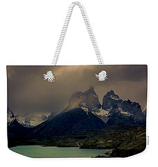 Weekender Tote Bag featuring the photograph Ominous Peaks by Andrew Matwijec