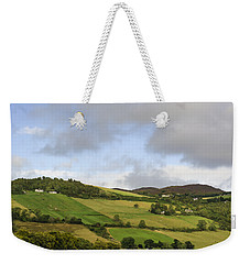 Weekender Tote Bag featuring the photograph On A Hill by Christi Kraft
