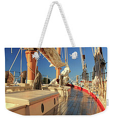 Weekender Tote Bag featuring the photograph On Deck Of The Schooner Eastwind by Roupen  Baker
