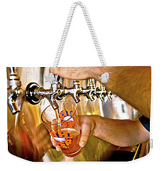 Weekender Tote Bag featuring the photograph On Tap by Linda Unger
