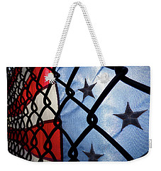 Weekender Tote Bag featuring the photograph On The Fence by Robert Geary