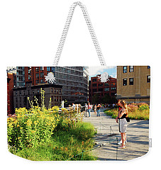 Weekender Tote Bag featuring the photograph On The High Line by James Kirkikis