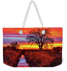 Weekender Tote Bag featuring the photograph On The Horizon by Greg Norrell