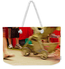 Weekender Tote Bag featuring the photograph On The Move by Kae Cheatham
