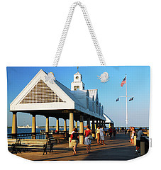 Weekender Tote Bag featuring the photograph On The Pier by James Kirkikis