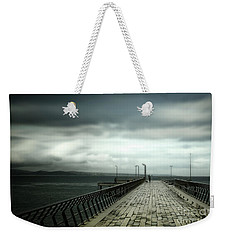 Weekender Tote Bag featuring the photograph On The Pier by Perry Webster