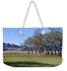 Weekender Tote Bag featuring the photograph On The Ranch by Ely Arsha