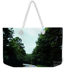 Weekender Tote Bag featuring the photograph On The Road by Andrea Anderegg