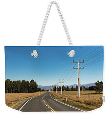 Weekender Tote Bag featuring the photograph On The Road by Gary Eason