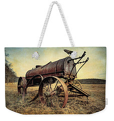Weekender Tote Bag featuring the photograph On The Water Wagon - Agricultural Relic by Gary Heller