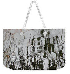 Weekender Tote Bag featuring the photograph On Waivers by Brian Boyle