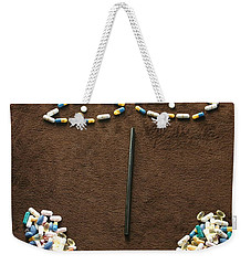 Weekender Tote Bag featuring the photograph One Pill Makes You...go Ask Alice by Marie Neder
