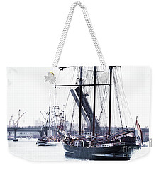 Weekender Tote Bag featuring the photograph Oosterschelde Leaving Port by Stephen Mitchell