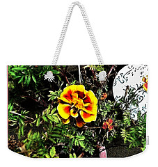 Weekender Tote Bag featuring the photograph Orange And Yellow Flower by Joan  Minchak