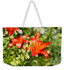 Weekender Tote Bag featuring the photograph Orange Fire by Rebecca Davis
