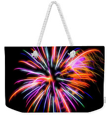 Weekender Tote Bag featuring the photograph Orange Fireworks by Yulia Kazansky
