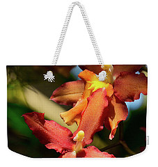 Weekender Tote Bag featuring the photograph Orange Leap by Richard Goldman