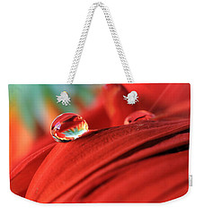 Orange Petals And Water Drops Weekender Tote Bag by Angela Murdock