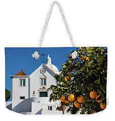 Weekender Tote Bag featuring the photograph Orange Tree And Church - Castro Marim, Portugal by Barry O Carroll