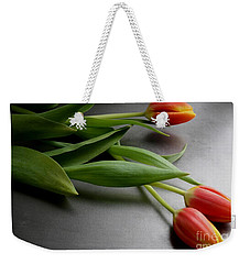 Weekender Tote Bag featuring the photograph Orange Tulips by Mary-Lee Sanders