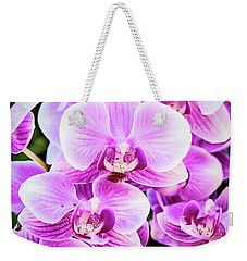 Weekender Tote Bag featuring the photograph Orchid Cascade by Jessica Manelis