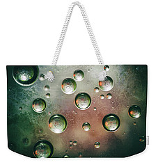 Weekender Tote Bag featuring the photograph Organic Silver Oil Bubble Abstract by John Williams