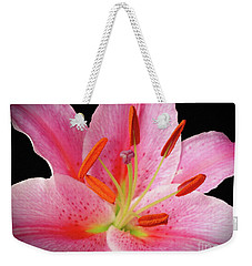 Weekender Tote Bag featuring the photograph Oriental Beauty by Sue Melvin