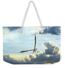 Osprey Flying In Clouds At Sunset With Fish In Talons Weekender Tote Bag