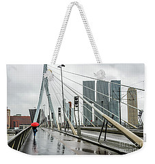 Weekender Tote Bag featuring the photograph Over The Erasmus Bridge In Rotterdam With Red Umbrella by RicardMN Photography