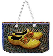 Weekender Tote Bag featuring the photograph Oversized Dutch Clogs by Hanny Heim