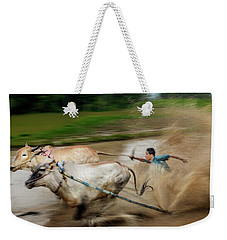 Weekender Tote Bag featuring the photograph Pacu Jawi Bull Race Festival by Pradeep Raja Prints