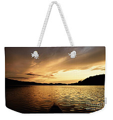 Weekender Tote Bag featuring the photograph Paddling At Sunset On Kekekabic Lake by Larry Ricker