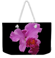 Weekender Tote Bag featuring the photograph Painted Orchid by Phyllis Denton