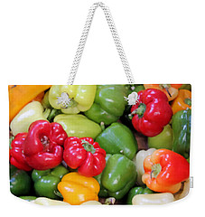 Weekender Tote Bag featuring the photograph Painted Peppers by Kristin Elmquist