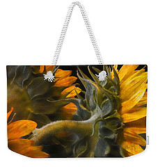 Weekender Tote Bag featuring the photograph Painted Sun Flowers by John Rivera