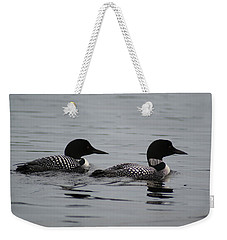 Weekender Tote Bag featuring the photograph Pair Of Loons by Steven Clipperton