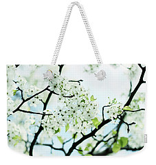 Weekender Tote Bag featuring the photograph Pale Pear Blossom by Jessica Jenney